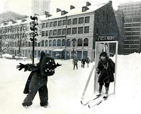 December 29, 1976:  As part of the countdown to First Night 1977, Mark Dannenhauer skied through the First Night doorway as Dancing Bear (Ellie Hayes) looked on. The pair from the Northeast Puppet Theater rehearsed in waterfront park for their First Night performance.