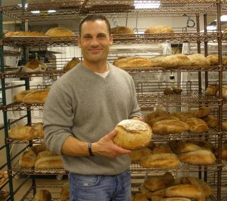 Joe Faro amid the fresh bread at his Tuscan Market in Salem, N.H.