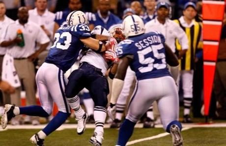 Colts defenders pounced on Kevin Faulk before he could pick up the crucial first down in the final minutes.