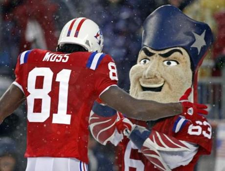 Randy Moss celebrated one of his three touchdowns with the Patriots' mascot.