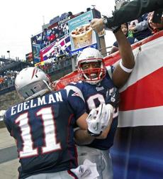 Julian Edelman congratulated Alge Crumpler after this third-quarter touchdown.