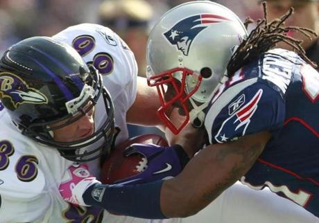 Brandon Meriweather levied a big hit on Ravens tight end Todd Heap during the first quarter.