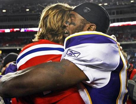 Vikings receiver Randy Moss embraced Tom Brady after the game.
