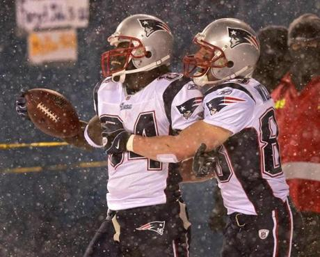 Wes Welker, right, celebrated with Deion Branch after the receiver's touchdown just before halftime.