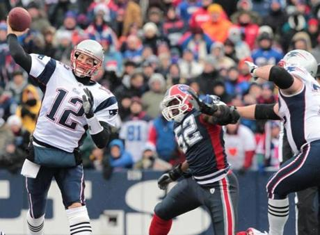 Tom Brady threw for three touchdown passes against the Bills.