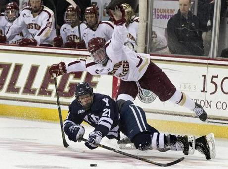 The Boston College Eagles' Pat Mullane defended Yale University Bulldogs' Colin Dueck during third period action at Conte Forum.