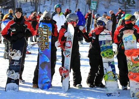 Snowboard instructors waited for their class assignments at Wachusett Mountain.