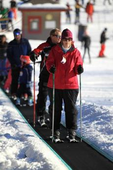 Ann Dirr rode the magic carpet while learning to ski.