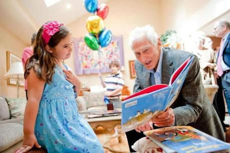 Harold Grinspoon delivers a book through PJ Library, which his foundation supports.