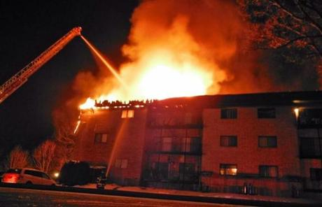 Lowell firefighters helped fight the blaze at the Littleton Road condominium complex on Saturday in Chelmsford, in which two people died and four others were injured.