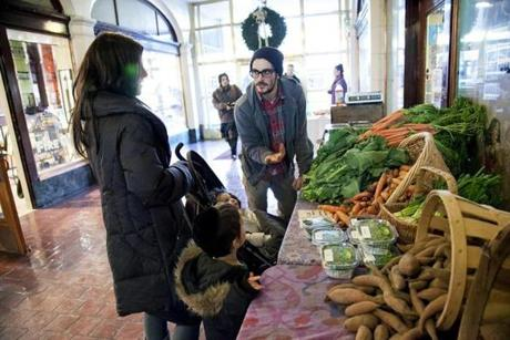Andrew Thornhill of Silverbrook Farm sells produce to a customer.