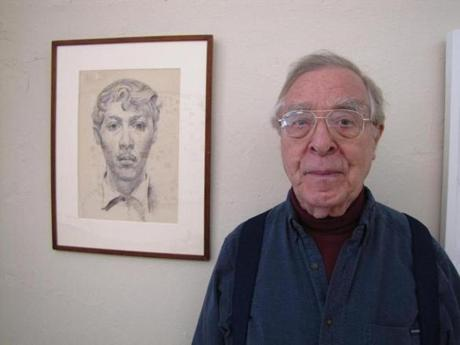 Jarvis Rockwell, son of Norman Rockwell, stood next to an early self-portrait that hangs in his studio on Main Street.