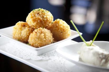 "A ""tiny plate"" of fontina and truffle oil-infused tater tots."