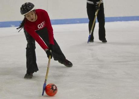 Jessie Frick took a shot on goal during her Sunday night broomball game.