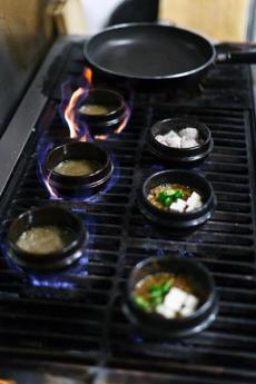 The stove at Moon-teok Om-neun Pap-chip (No Threshold Restaurant).