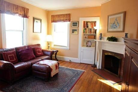 The family room is connected to the living room and has a built-in fireplace.