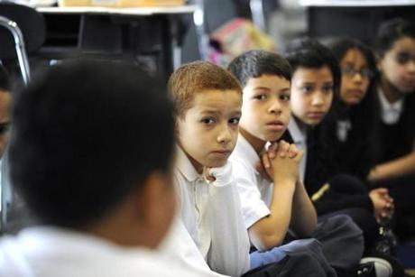 Fourth grade students discuss their ideas for letters they will write to President Obama as part of Mail to the Chief program. At left (back to camera), Jesus Marquez gives his thoughts.