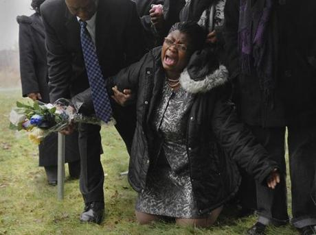 Marie Rene Brezault, a Boston resident originally from Haiti, cried out the names of relatives lost in the 2010 Haiti earthquake during a memorial ceremony at the New Calvary Cemetery in Mattapan.