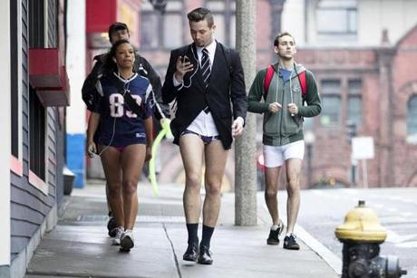 Jason Triplett, front, Jen Kent, left, Ryan Norton, left back, and Matthew Masters, right, walked to Kings bowling alley for a party after participating in Boston's 6th annual No Pants Subway Ride.