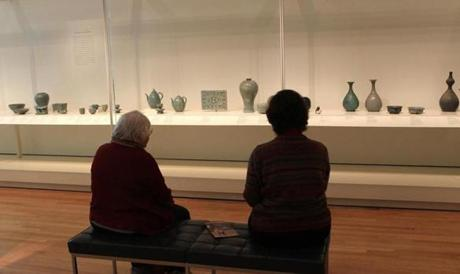 Two women sat down at the Korean gallery.