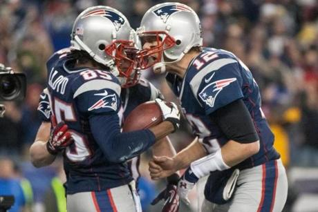 Brandon Lloyd is congratulated by Tom Brady after his 5-yard touchdown reception in the third quarter.
