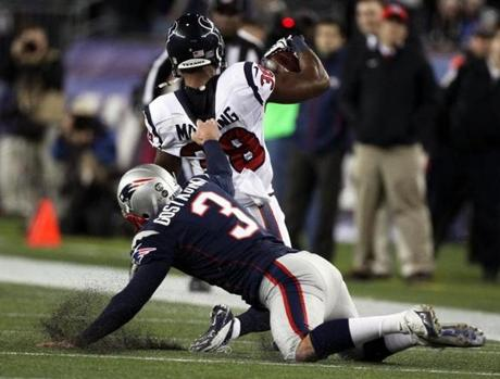 Patriots kicker Stephen Gostkowski received a 15-yard penalty for this horse collar tackle of the Texans' Danieal Manning at the end of a 35-yard kickoff return at Gillette Stadium.