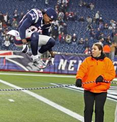 Patriots wide receiver Brandon Lloyd leaped over a security rope as he headed off the field at Gillette Stadium after New England's 41-28 victory over the Houston Texans propelled them to the AFC Championship.