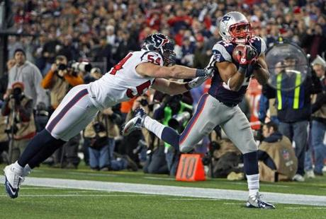Patriots running back Shane Vereen headed into the end zone after he hauled in a 33-yard pass from Tom Brady for a touchdown that helped seal the New England victory over Houston  in the NFL Divisional Playoff Game at Gillette Stadium.