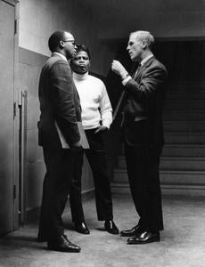April 5, 1968:  City Councilor Thomas Atkins, left, and Boston Mayor Kevin White, right, spoke with entertainer James Brown at the Boston Garden. It was one day after the assassination of  King and there was concern that the James Brown concert at the Boston Garden could create further unrest in the city. A decision was made to televise the concert so that Brown could be widely heard and yet the assembly of a large crowd could be avoided. During the introduction of Mayor White, Brown interjected saying,