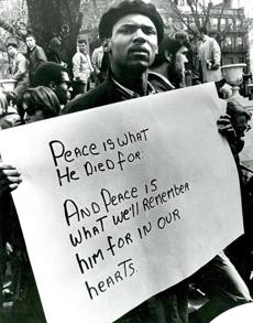 April 5, 1968: A mourner held a placard as thousands massed on Boston Common opposite the State House to pay tribute to the Rev. Martin Luther King Jr. who was assassinated in Memphis on  April 4, 1968.