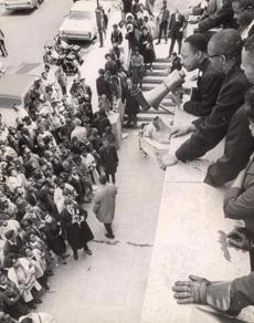 April 22, 1965: The Rev. Martin Luther King Jr. used a bullhorn to address the crowd at the Patrick T. Campbell Middle School in Roxbury. On segregation he told the crowd,