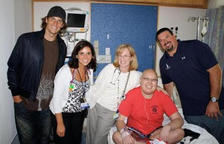 Abdruzzi (right) at Children's Hospital with (from left) Patriots quarterback Tom Brady, Drs. Laura McCullough and Elizabeth Mullen, and cancer patient Katie Johnson in 2010.