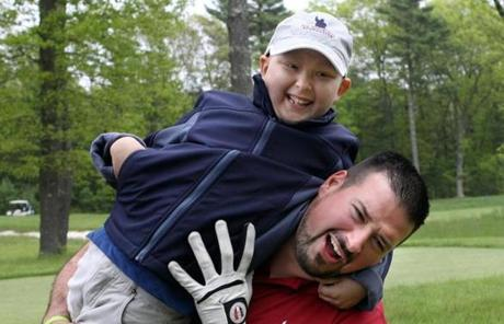 Andruzzi with 6 year-old Ethan Bairos in 2011. Andruzzi started visiting cancer patients as a Patriots player and stuck around after the cameras stopped rolling.