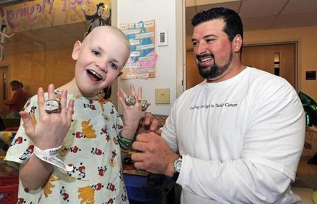 After a year of intensive treatment, Andruzzi's cancer was gone.  He kept visiting patients and started his foundation.