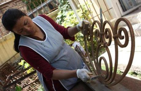 A worker cleaned wrought iron.