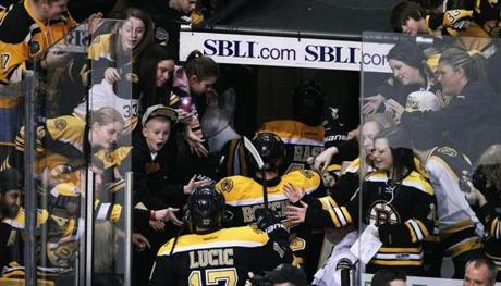 1/15/13: Boston, MA: Fans cheer as the Bruins leave the ice following pre game warmups. The Boston Bruins played against their minor league affiliate the Providence Bruins in the annual