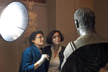 Pam Hatchfield, left, head of objects conservation at the MFA, and Isabella Damiani, curator at the Capitoline Museum in Rome, looked over a rare bronze sculpture of a Roman statesman that dates to around 300 BC as it arrived at the MFA during its first visit to the United States.