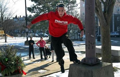 Blake Evitt, an instructor with Parkour Generations Americas, led students up stairs during a morning session at Somerville High School.