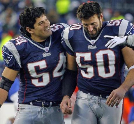 Mike Vrabel, right, with Tedy Bruschi, won three Super Bowls with the Patriots.