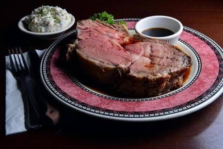 A King Cut (22 oz.) prime rib, with a side of mashed potatoes.
