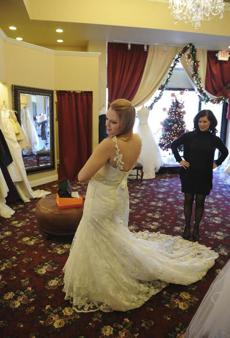 Madeline Herec of Brighton tried on a wedding dress at Sabella Couture in Boston.