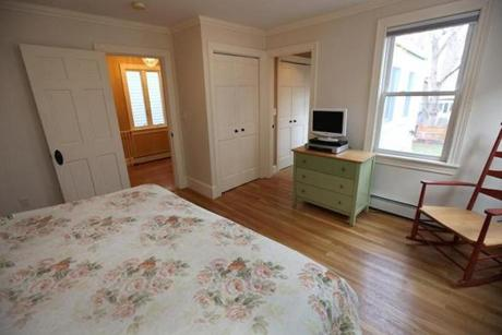 A third room on the second floor is a small office or bedroom.