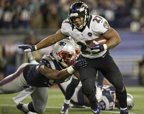 The Ravens' Ray Rice slips away from New England Patriots linebacker Dont'a Hightower for a touchdown in the second quarter.