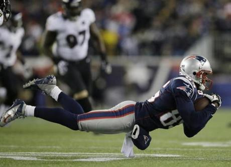 New England Patriots wide receiver Brandon Lloyd makes a catch during the first half.
