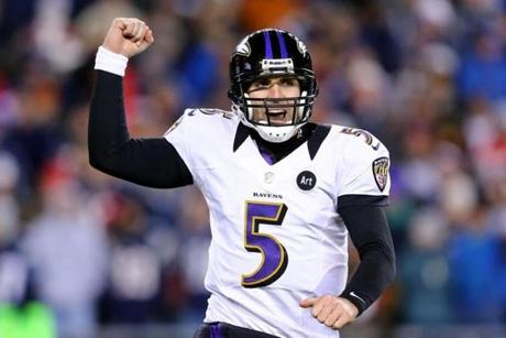 Joe Flacco celebrates after throwing a touchdown pass to Anquan Boldin in the fourth quarter.