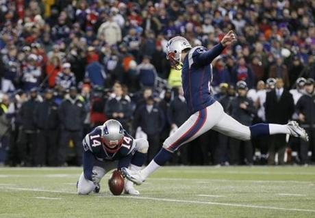 New England Patriots kicker Stephen Gostkowski closes out the first half as punter Zoltan Mesko holds the ball.