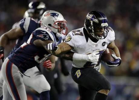New England Patriots free safety Devin McCourty pursues Baltimore Ravens running back Ray Rice  during the first half.