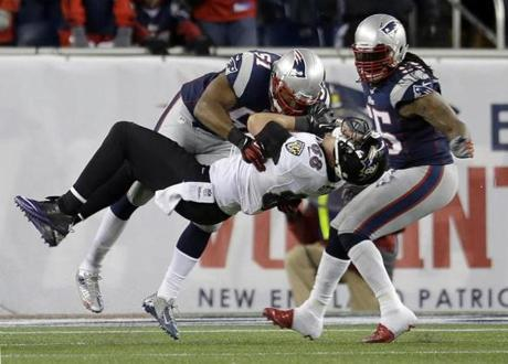 New England Patriots linebacker Jerod Mayo tackles Baltimore Ravens tight end Dennis Pitta after a reception in the second half.