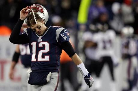 New England Patriots quarterback Tom Brady removes his helmet after throwing an interception with 1:13 left in the game.
