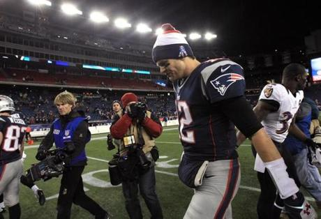 Patriots quarterback Tom Brady walks off the field following the team's loss to the Ravens.